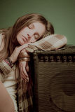 A beautiful teenage girl sleeping on a sound device Stock Images