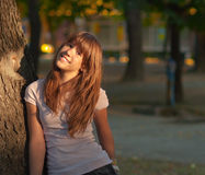 Beautiful teenage girl smiles in the park Royalty Free Stock Photography