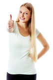 Beautiful teenage girl smiling and doing the thumbs-up sign. Stock Images