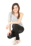 Beautiful teenage girl smiling, full length Royalty Free Stock Photo