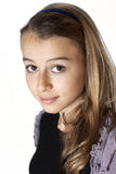 Beautiful teenage girl smiling and looking into the camera. Stock Photography