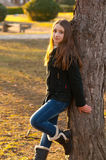 Beautiful teenage girl standing in the park Royalty Free Stock Photo