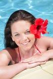 Beautiful teenage girl in swimming pool stock images