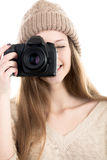 Beautiful teenage girl taking pictures with digital camera royalty free stock image