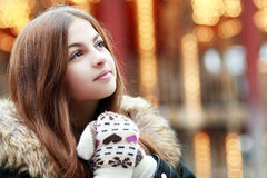 Beautiful teenage girl. Think over city lights winter season royalty free stock images
