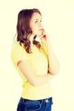 Beautiful teenage girl is thinking Royalty Free Stock Photos