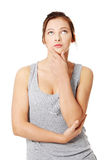 Beautiful teenage girl is thinking and looking up. Royalty Free Stock Images