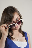 Beautiful teenage girl wearing heart sunglasses Stock Images