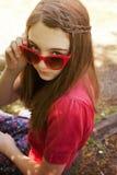 Beautiful teenage girl wearing retro sunglasses Stock Photos