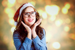 Beautiful teenage girl wearing Santa hat and funny Stock Images