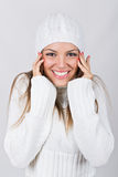 Beautiful teenage girl wearing white beanie hat and sweater Royalty Free Stock Images
