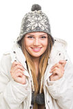 Beautiful teenage girl wearing winter jacket and knitted beanie hat posing Stock Image