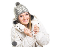 Beautiful teenage girl wearing winter jacket and knitted hat Stock Photos