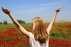 Beautiful Teenage Girl on the wildflowers field Stock Image