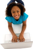 Beautiful teenage girl working on labtop Stock Images