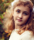 Beautiful teenage girl 10 years old, adorable face looking strai Royalty Free Stock Photography