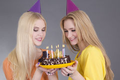 Beautiful teenage girls with birthday cake Stock Photos