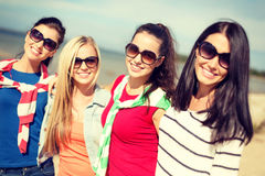 Beautiful teenage girls having fun on the beach Stock Photo