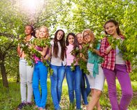 Beautiful teenage girls hold benches with leaves Stock Photography