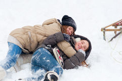 Beautiful teenage girls playing in the snow Stock Image