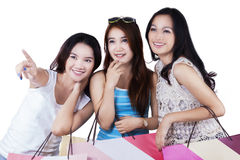 Beautiful teenage girls with shopping bags Royalty Free Stock Images