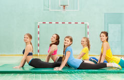 Beautiful teenage girls working out in gym Stock Photo