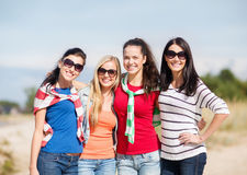 Beautiful teenage girls or young women having fun. Summer, holidays, vacation, happy people concept - beautiful teenage girls or young women having fun on the royalty free stock images