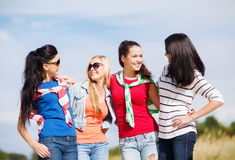 Beautiful teenage girls or young women having fun. Summer, holidays, vacation, happy people concept - beautiful teenage girls or young women having fun on the royalty free stock photo