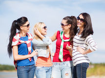 Beautiful teenage girls or young women having fun. Summer, holidays, vacation, happy people concept - beautiful teenage girls or young women having fun on the stock images
