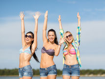 Beautiful teenage girls or young women having fun. Summer, holidays, vacation, happy people concept - beautiful teenage girls or young women having fun on the royalty free stock photography