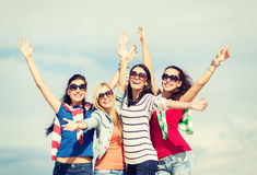 Beautiful teenage girls or young women having fun. Summer, holidays, vacation, happy people concept - beautiful teenage girls or young women having fun on the royalty free stock image