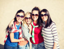 Beautiful teenage girls or young women having fun. Summer, holidays, vacation, happy people concept - beautiful teenage girls or young women having fun on the stock photography