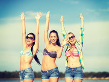Beautiful teenage girls or young women having fun. Summer, holidays, vacation, happy people concept - beautiful teenage girls or young women having fun on the stock photo