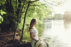 Beautiful teenage model dressed in fashionable dress. Beauty romantic girl outdoor. Beautiful teenage model dressed in fashionable dress. Toned in warm colors royalty free stock image