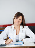 Beautiful Teenage Schoolgirl Sitting At Desk Stock Photography