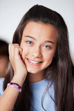Beautiful Teenage Schoolgirl In Smiling Classroom Royalty Free Stock Image