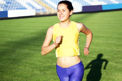 Beautiful teenage sport girl running Stock Images