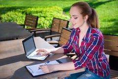 Beautiful teenage student or school girl doing her homework in p Royalty Free Stock Photo