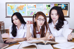 Beautiful teenage students studying in the class Royalty Free Stock Photo