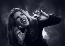 Beautiful teenage vampire Stock Photo