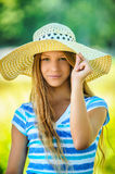 Beautiful teenage in wide-brimmed hat Royalty Free Stock Photos