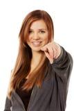 Beautiful teenage woman pointing at camera Stock Images