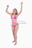 Beautiful teenager in beachwear playing hula-hoop Royalty Free Stock Photos