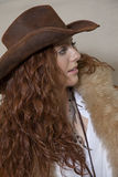 Beautiful teenager with cowboy hat and fur looking away Stock Photo