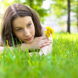 Beautiful teenager with dandelion bouquet Stock Photos