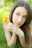Beautiful teenager with dandelion on lawn Stock Photography