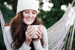 Beautiful teenager drinking coffee Royalty Free Stock Photos