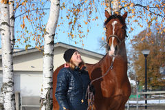 Beautiful teenager girl and bay horse portrait in autumn Stock Photos