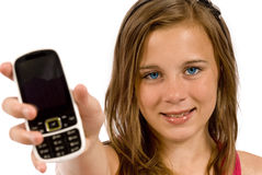 Teenager With Cell Phone Close Up. Beautiful teenager girl with braces smiling at the camera while holding her cell phone.  White background.  Close up shot Royalty Free Stock Images