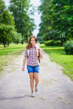 Beautiful teenager girl in casual clothes going to school. On sunny september day, outdoor portrait stock image